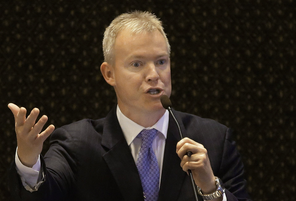 Photo - FILE - In this May 24, 2013 file photo, Illinois Rep. Brandon Phelps, D-Harrisburg, argues concealed carry gun legislation at the Illinois State Capitol in Springfield. Gov. Pat Quinn predicted a