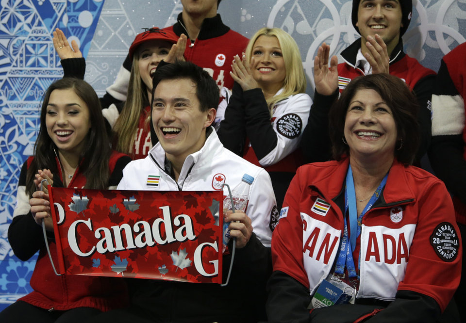 Photo - Patrick Chan of Canada, centre, and his team members wait for his results after he competed in the men's team short program figure skating competition at the Iceberg Skating Palace during the 2014 Winter Olympics, Thursday, Feb. 6, 2014, in Sochi, Russia. (AP Photo/Darron Cummings, Pool)