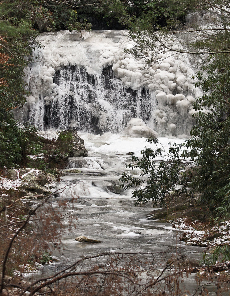 Photo - Meigs Falls in the Great Smoky Mountains National Park is covered in ice, Monday, Jan. 27 2014, due the cold weather in East Tennessee for the past couple of weeks as another Arctic blast heads to the area this week with temperatures falling to single digits Tuesday and Wednesday night in Maryville, Tenn. (AP Photo/The Daily Times, Tom Sherlin)