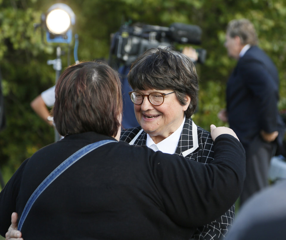 Photo - Sister Helen Prejean, right, talks with Debra Ogden, of Choctaw, niece of Richard Glossip, after the scheduled execution of Richard Eugene Glossip was stayed at the Oklahoma State Penitentiary in McAlester, Okla., Wednesday, Sept. 30, 2015. Gov. Fallin stayed the execution for 37 days. Photo by Nate Billings, The Oklahoman