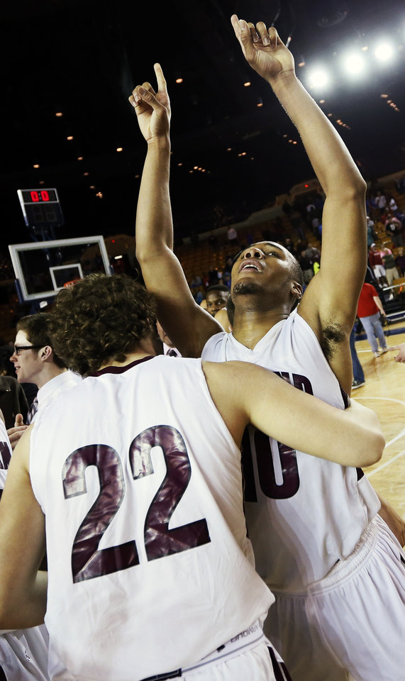 Edmond Memorial's Jordan Woodard (10) celebrates with Jason Hand (22) after Woodard made the game-winning tip-in against Midwest City during the Class 6A boys championship high school basketball game in the state tournament at the Mabee Center in Tulsa, Okla., Saturday, March 9, 2013. Edmond Memorial won, 49-48. Photo by Nate Billings, The Oklahoman