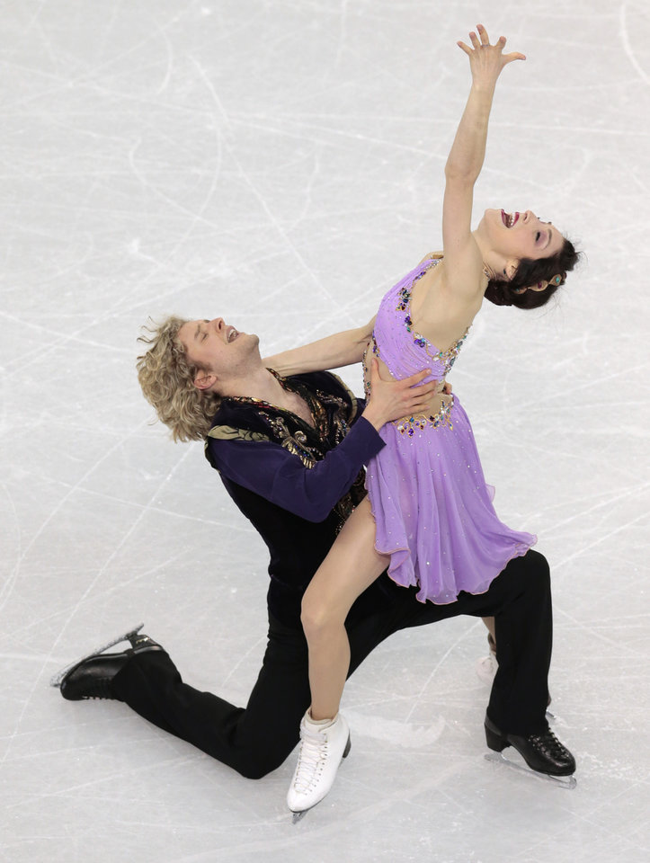 Photo - Meryl Davis and Charlie White of the United States compete in the ice dance free dance figure skating finals at the Iceberg Skating Palace during the 2014 Winter Olympics, Monday, Feb. 17, 2014, in Sochi, Russia. (AP Photo/Ivan Sekretarev)