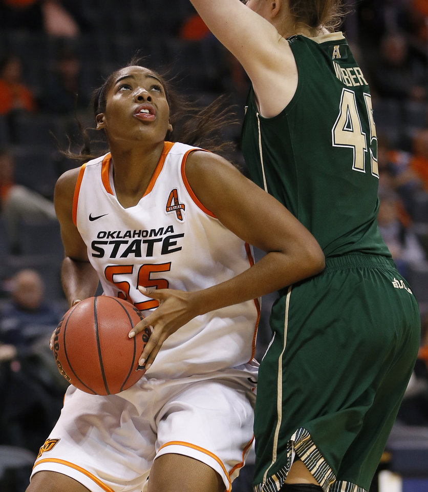 Oklahoma State's LaShawn Jones (55) looks towards the basket beside South Florida's Katelyn Weber (45) during the All-College Classic women's basketball game between Oklahoma State University and South Florida at Chesapeake Energy Arena in Oklahoma City, Okla., Saturday, Dec. 14, 2013. Photo by Bryan Terry, The Oklahoman