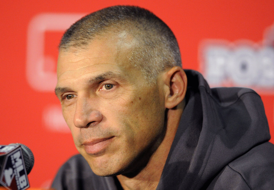 Photo -   New York Yankees manager Joe Girardi speaks during a news conference before Game 2 of the American League division baseball series against the Baltimore Orioles on Monday, Oct. 8, 2012, in Baltimore. (AP Photo/Nick Wass)