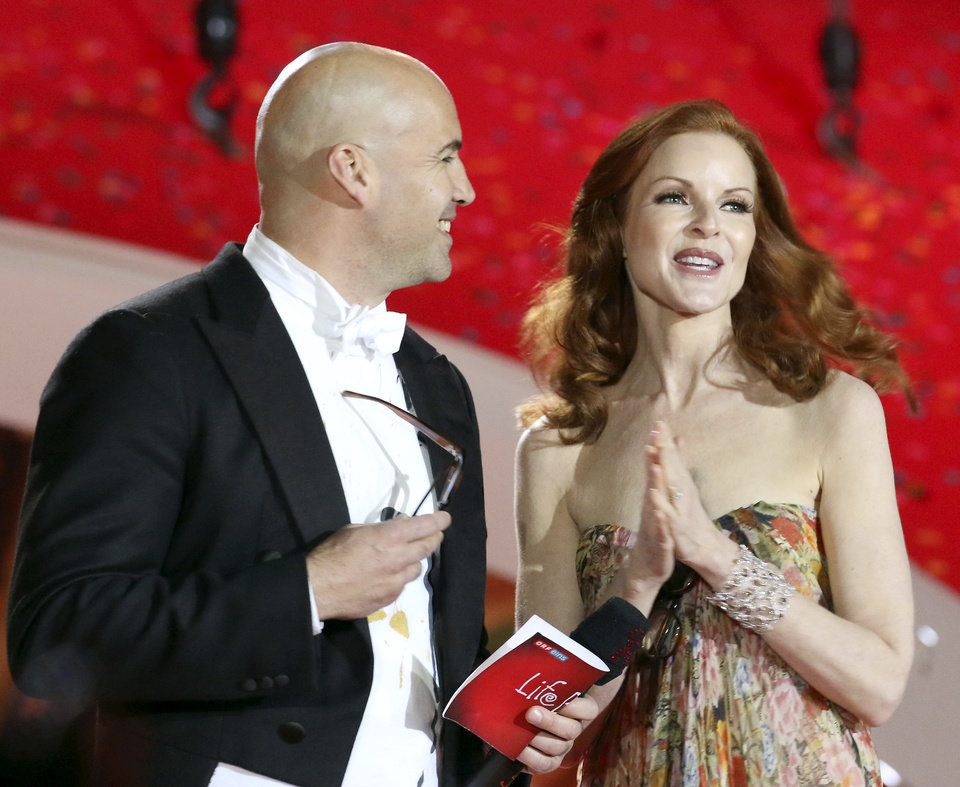 Photo - Actor Billy Zane and actress Marcia Cross speak during the opening ceremony of the Life Ball in front of City Hall in Vienna, Austria, Saturday, May 31, 2014. The Life Ball is a charity gala to raise money for people living with HIV and AIDS. (AP Photo/Ronald Zak)