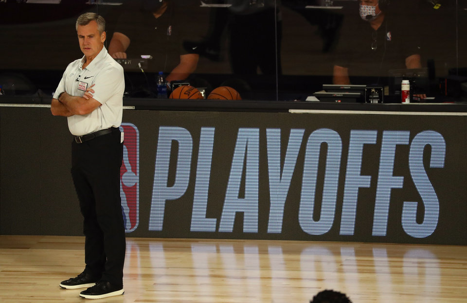 Photo - Aug 18, 2020; Lake Buena Vista, Florida, USA; Oklahoma City Thunder head coach Billy Donovan looks on during the first half against the Houston Rockets in game one of the first round of the 2020 NBA Playoffs at The Field House. Mandatory Credit: Kim Klement-USA TODAY Sports