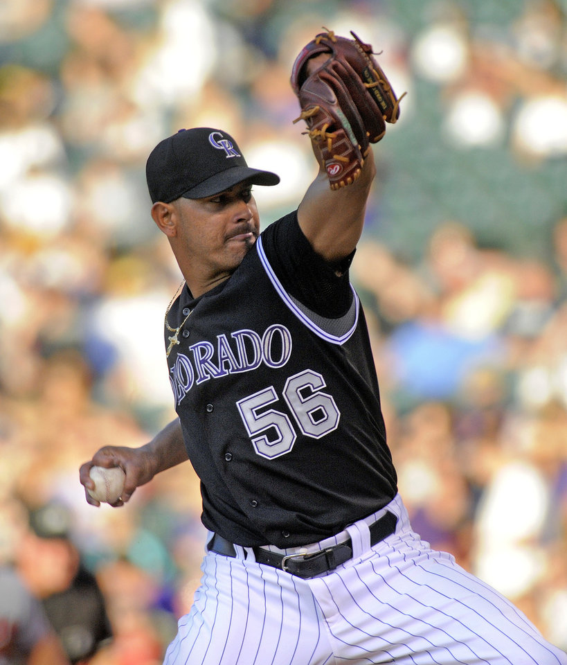 Photo -   Colorado Rockies starting pitcher Guillermo Moscoso throws to the plate against the Atlanta Braves during the second inning of a baseball game, Friday, May 4, 2012, in Denver. (AP Photo/Jack Dempsey)