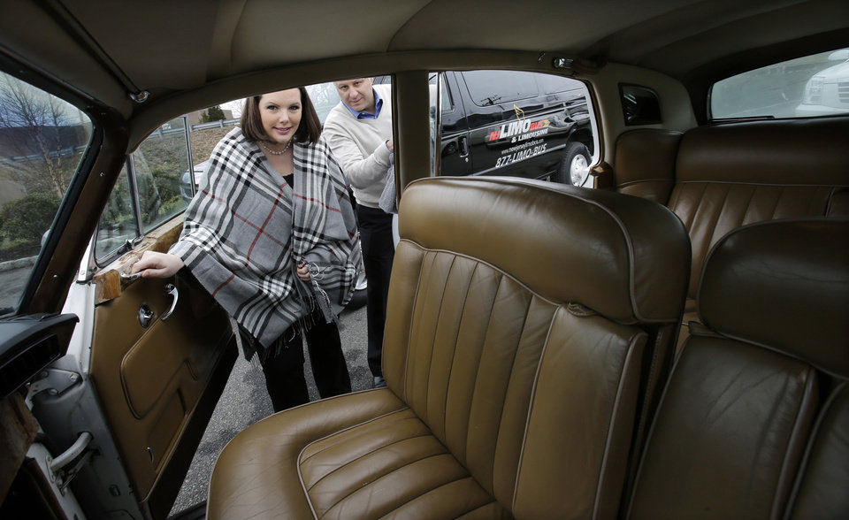 Photo - In this Tuesday, Jan. 15, 2013, photo, Joe Brasco and his wife Ann Marie Brasco, of  New Jersey Limo Bus & Limousine, prepare a Rolls Royce in Fairfield, N.J. The flu season has created a scramble for New Jersey Limo Bus & Limousine as two of the company's seven full-time employees called in sick at the same time, but the Brascos have managed to find substitutes when workers have called in sick. (AP Photo/Mel Evans)