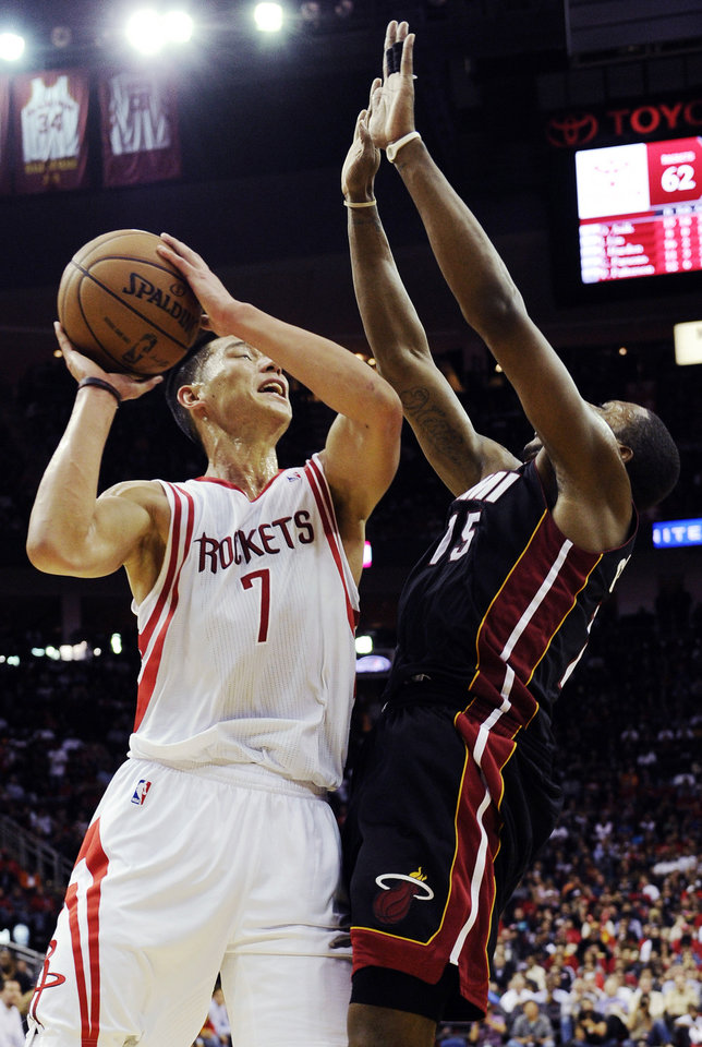 Houston Rockets' Jeremy Lin (7) is fouled by Miami Heat's Mario Chalmers in the second half of an NBA basketball game, Monday, Nov. 12, 2012, in Houston. The Heat won 113-110.(AP Photo/Pat Sullivan)