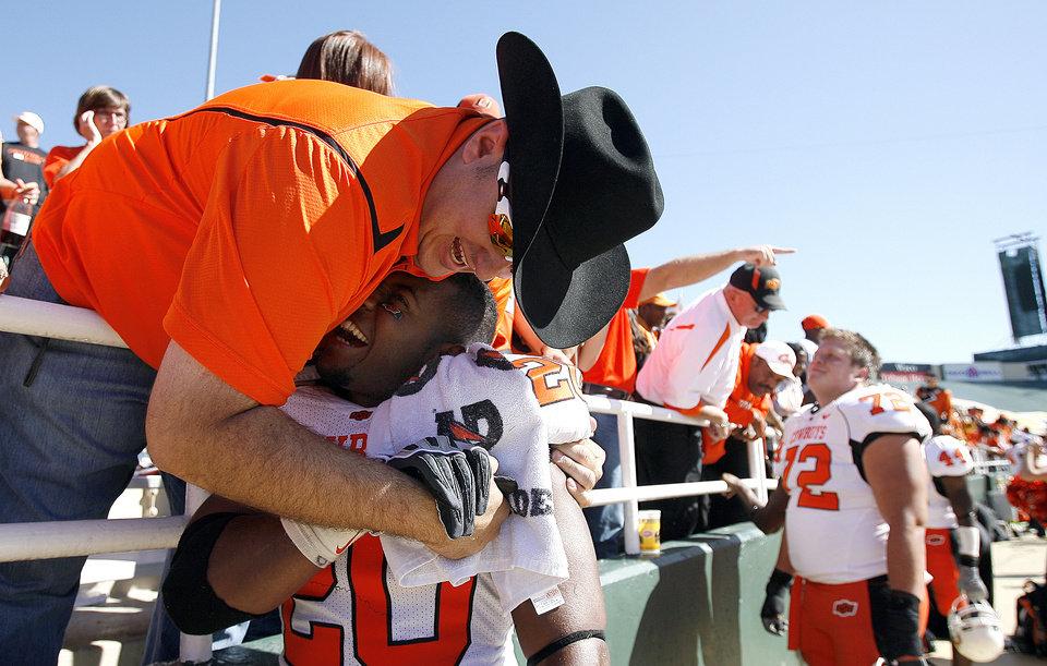 Photo - John Pulver of Stillwater, Okla., congratulates Andre Sexton (2) following the college football game between Baylor University and Oklahoma State University (OSU) at Floyd Casey Stadium in Waco, Texas, Saturday, Oct. 24, 2009.  Photo by Sarah Phipps, The Oklahoman