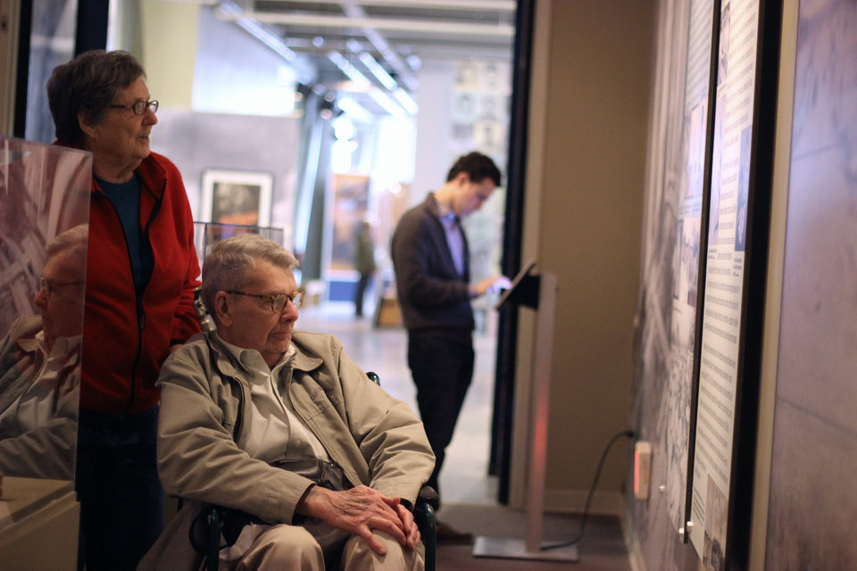 "In this March 26, 2014 photo, Nancy and Charles Hardy read about the experience of Japanese-Americans sent to internment camps during World War II as they enter an exhibit titled ""Barbed Wire to Battlefields"" at the National World War II Museum in New Orleans. (AP Photo/Janet McConnaughey)"