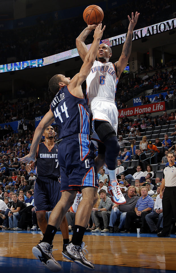 Photo - Oklahoma City's Eric Maynor (6) shoots over Charlotte's Jeffery Taylor (44) during the preseason NBA game between the Oklahoma City Thunder and the Charlotte Bobcats at Chesapeake Energy Arena in Oklahoma City, Tuesday, Oct. 16, 2012. Photo by Sarah Phipps, The Oklahoman