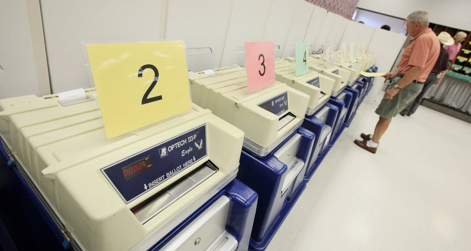 Photo - Voting machines lined up during at the Oklahoma County Election Board. Photo by Paul B. Southerland, The Oklahoman