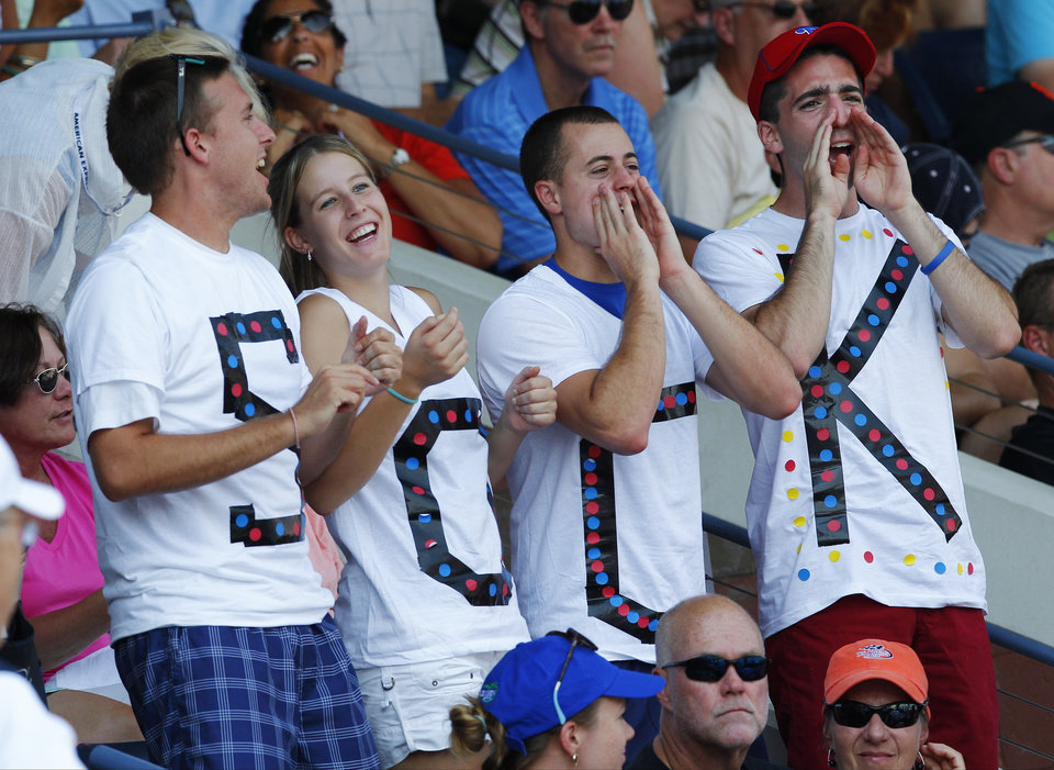 Photo -   Fans of Jack Sock cheer during his match against Spain's Nicolas Almagro in the third round of play at the 2012 US Open tennis tournament, Saturday, Sept. 1, 2012, in New York. (AP Photo/Paul Bereswill)