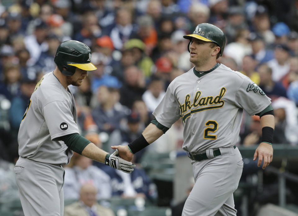 Oakland Athletics' Cliff Pennington scores during the third inning of Game 2 of the American League division baseball series against the Detroit Tigers, Sunday, Oct. 7, 2012, in Detroit. (AP Photo/Paul Sancya)