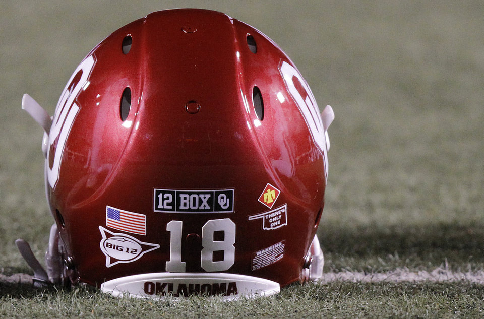 Photo - The OU helmet during the Bedlam college football game between the Oklahoma State University Cowboys (OSU) and the University of Oklahoma Sooners (OU) at Boone Pickens Stadium in Stillwater, Okla., Saturday, Dec. 3, 2011. Photo by Chris Landsberger, The Oklahoman