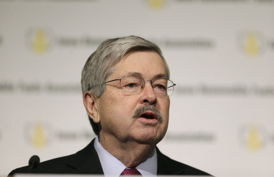 Photo - Iowa Gov. Terry Branstad speaks during the Iowa Renewable Fuels Association Summit, Tuesday, Jan. 28, 2014, in Altoona, Iowa. Branstad says he feels momentum is with Iowa and other farm states pushing the EPA to reverse a plan to cut the amount of biofuels blended into gasoline this year. (AP Photo/Charlie Neibergall)