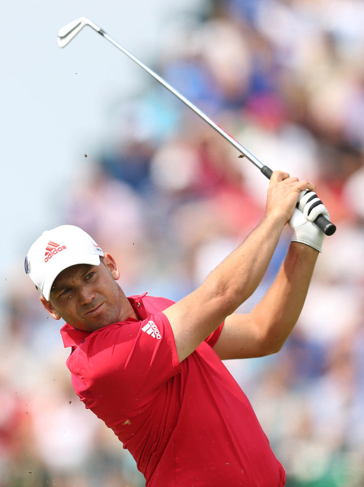 Photo - Sergio Garcia of Spain plays a shot off the 4th tee during the second day of the British Open Golf championship at the Royal Liverpool golf club, Hoylake, England, Friday July 18, 2014. (AP Photo/Scott Heppell)
