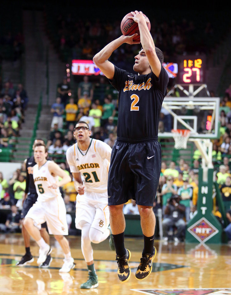 Photo - Long Beach State's Peter Pappageorge (2) attempts a shot as Baylor's Isaiah Austin (21) and Brady Heslip (5) trail during the first half of an NIT first-round college basketball game in Waco, Texas, Wednesday, March, 20, 2013. (AP Photo/Waco Tribune Herald, Rod Aydelotte)
