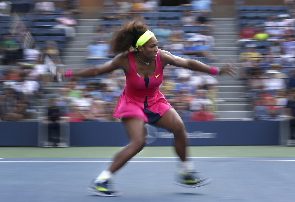 Photo -   In this photograph made with a slow shutter speed, Serena Williams returns a shot to Spain's Maria Jose Martinez Sanchez in the second round of play at the 2012 US Open tennis tournament, Thursday, Aug. 30, 2012, in New York. (AP Photo/Darron Cummings)