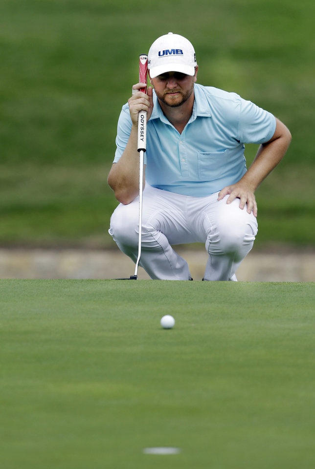 Photo - Brice Garnett lines up his putt on the 18th hole during the second round of the PGA Colonial golf tournament in Fort Worth, Texas, Friday, May 23, 2014. (AP Photo/LM Otero)