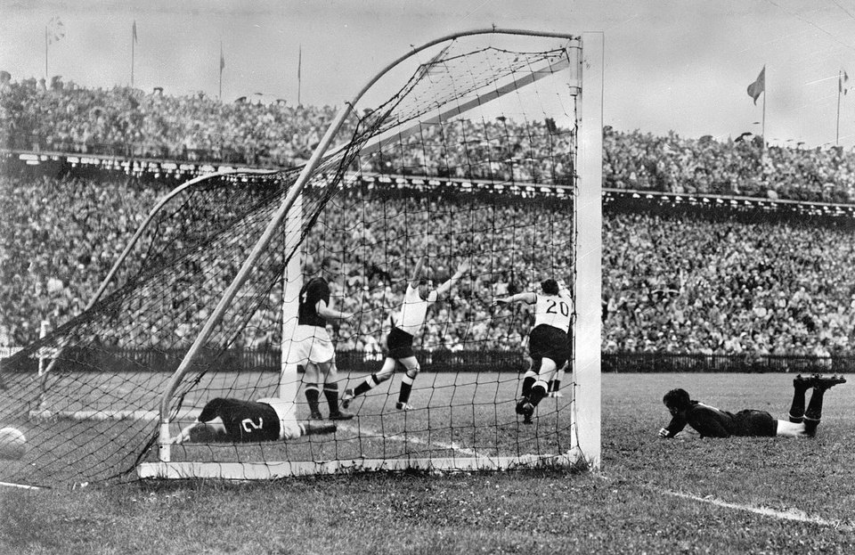 Photo - FILE - In this July 4, 1954 file photo, West Germany's Helmut Rahn, center with arms raised, celebrates after equalising in the World Cup soccer final match against Hungary, at Wankdorf Stadium, in Bern, Switzerland. On this day: West Germany comes back from 2-0 down to beat Hungary 3-2 and win its first World Cup. (AP Photo/File)