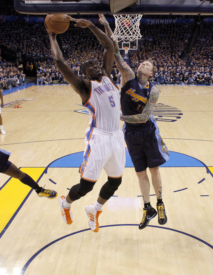 Photo - Oklahoma City's Kendrick Perkins (5) goes to the basket beside Denver's Chris Andersen (11) during the NBA basketball game between the Denver Nuggets and the Oklahoma City Thunder in the first round of the NBA playoffs at the Oklahoma City Arena, Wednesday, April 27, 2011. Photo by Bryan Terry, The Oklahoman