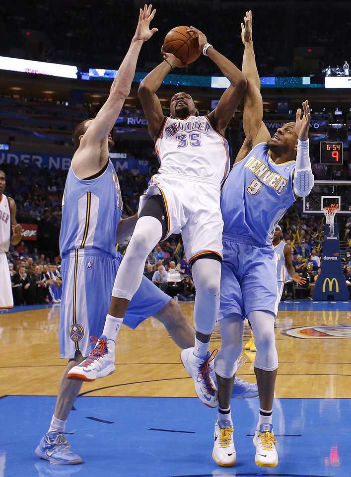 Oklahoma City's Kevin Durant (35) gets caught between Denver's Kosta Koufos (41) and Andre Iguodala (9) during an NBA basketball game between the Oklahoma City Thunder and the Denver Nuggets at Chesapeake Energy Arena in Oklahoma City, Tuesday, March 19, 2013. Denver won 114-104. Photo by Bryan Terry, The Oklahoman