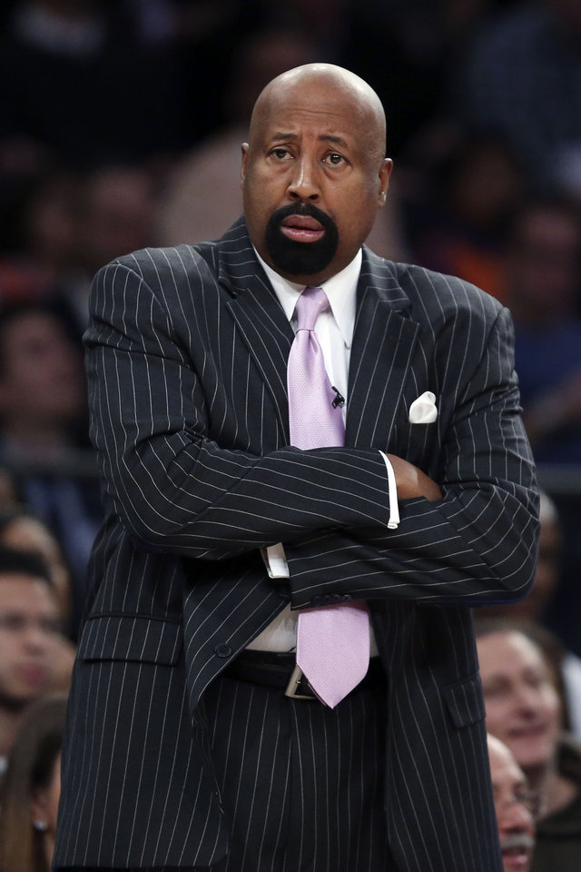 Photo - New York Knicks head coach Mike Woodson watches his players from the bench during the first half of their NBA basketball game against the Oklahoma City Thunder at Madison Square Garden, Wednesday, Dec. 25, 2013, in New York. (AP Photo/John Minchillo)