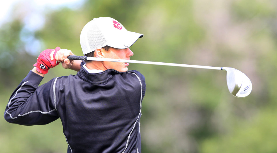 Photo - Dalton Rhoden, Fort Gibson, tees off in the Class 4A boys golf at Lake Hefner Golf Course, Tuesday May 13, 2014.  Photo by David McDaniel, The Oklahoman