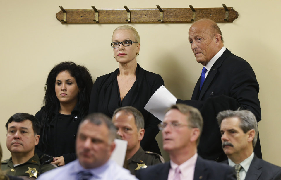 Photo - Jean Kasem, center, the wife of ailing radio personality Casey Kasem, waits with her attorney Joel Paget, right, and her daughter, Liberty Kasem, left, before appearing in Kitsap County Superior Court, Friday, May 30, 2014 in Port Orchard, Wash. Jean Kasem was in court as part of an ongoing dispute with her stepdaughter Kerri Kasem, who has been given authority to determine whether her father is receiving adequate medical care. Casey and Jean Kasem have been staying with family friends in Washington state. (AP Photo/Ted S. Warren)