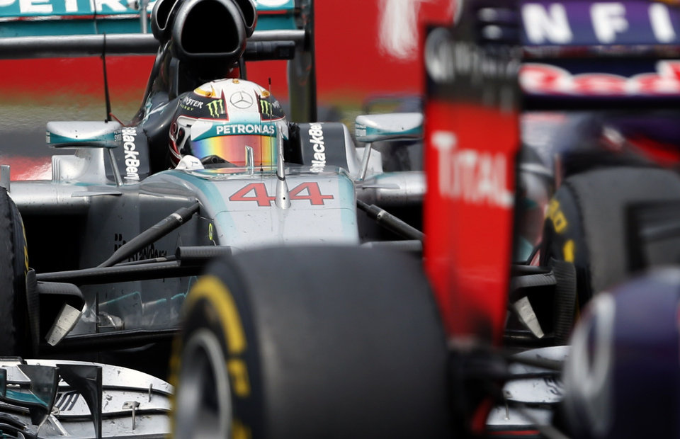 Photo - Mercedes driver Lewis Hamilton of Britain steers his car during the Hungarian Formula One Grand Prix in Budapest, Hungary, Sunday, July 27, 2014. Hamilton placed third in the race. (AP Photo/Darko Vojinovic)
