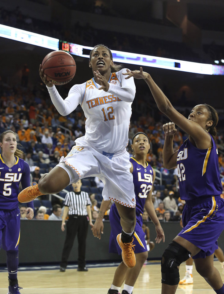 Photo - Tennessee forward Bashaara Graves (12) goes up for a shot against LSU forward Sheila Boykin (42) during an NCAA college basketball game in the quarterfinals of the Southeastern Conference women's tournament, Friday, March 7, 2014, in Duluth, Ga. (AP Photo/Jason Getz)
