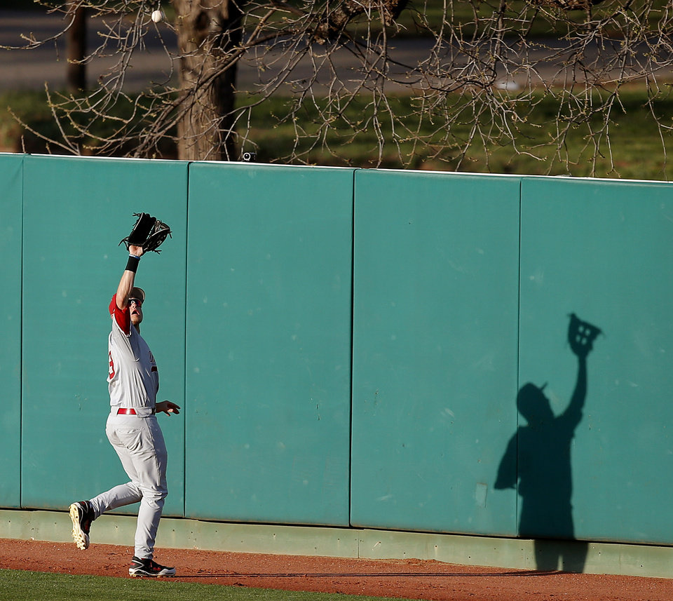 Photo - OU's Craig Aikin makes an catch for an out in the first inning during a Bedlam baseball game between Oklahoma State University and the University of Oklahoma in Stillwater, Okla., Tuesday, April 15, 2014. Photo by Bryan Terry, The Oklahoman