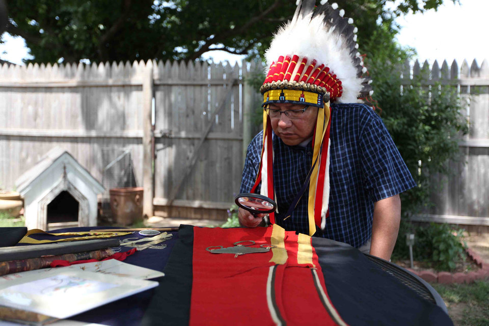 """Chief Gordon Yellowman of the Cheyenne-Arapaho Tribe examines the jewelry and clothing bellowing to George Bryson. Did these once belong to Chief Black Kettle, a Cheyenne Peace Chief?""  - Photo Provided"