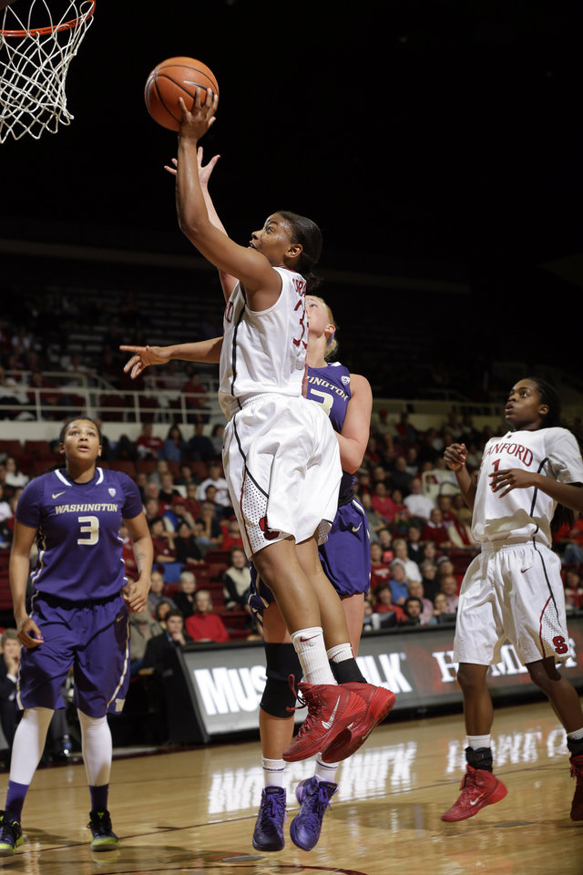 Photo - Stanford guard Amber Orrange, center, scores against Washington during the second half of an NCAA college basketball game on Thursday, Feb. 27, 2014, in Stanford, Calif. Stanford won 83-60. (AP Photo/Marcio Jose Sanchez)