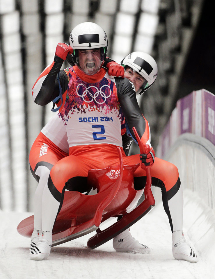 Photo - The doubles team of Andreas Linger and Wolfgang Linger from Austria celebrate in the finish area after their final run to win the silver medal during the men's doubles luge at the 2014 Winter Olympics, Wednesday, Feb. 12, 2014, in Krasnaya Polyana, Russia. (AP Photo/Jae C. Hong, File)