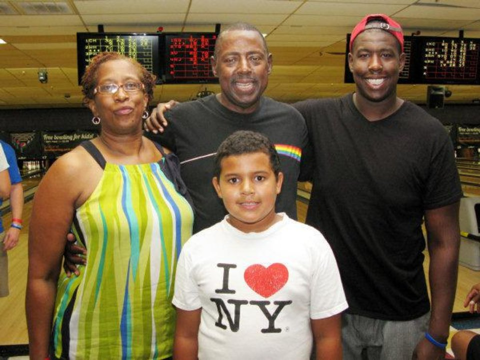 The family of Wilson Holloway, who died in February of Hodgkin's Lymphoma, take a break from bowling at Blake Griffin's fundraising event honoring their son. They are, clockwise from back left, mom and dad Penny and Willis Holloway Jr., and brothers Wesley, 21, and Conley, 10. PHOTO BY LILLIE-BETH BRINKMAN, THE OKLAHOMAN.   of Hodgkin's Lymphoma, bowls at the event honoring their son. <strong></strong>