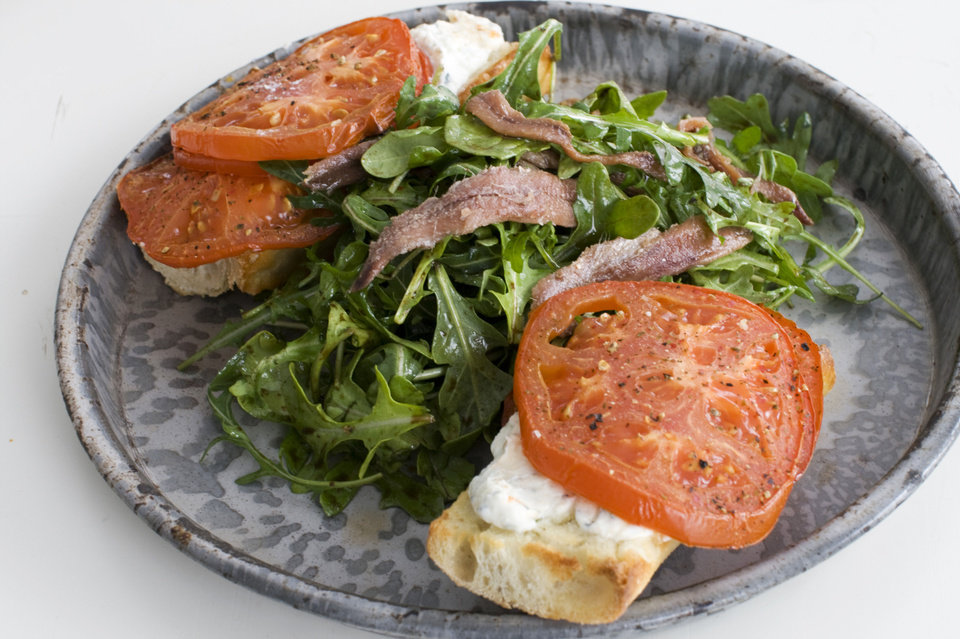An open-faced anchovy sandwich with balsamic arugula. <strong>Matthew Mead - AP</strong>