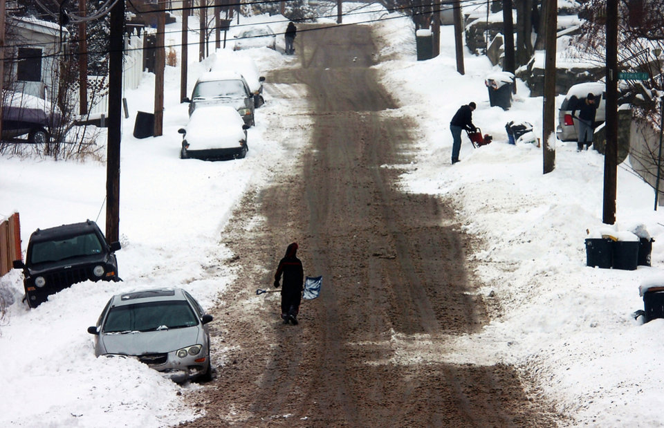 Photo - Residents with shovels and snow blowers start to clear out the snow along 8th Avenue in Carbondale, Pa. on Wednesday, Feb. 5, 2014 after the a snowstorm hit the area. (AP Photo/Scranton Times & Tribune, Butch Comegys)  WILKES BARRE TIMES-LEADER OUT; MANDATORY CREDIT