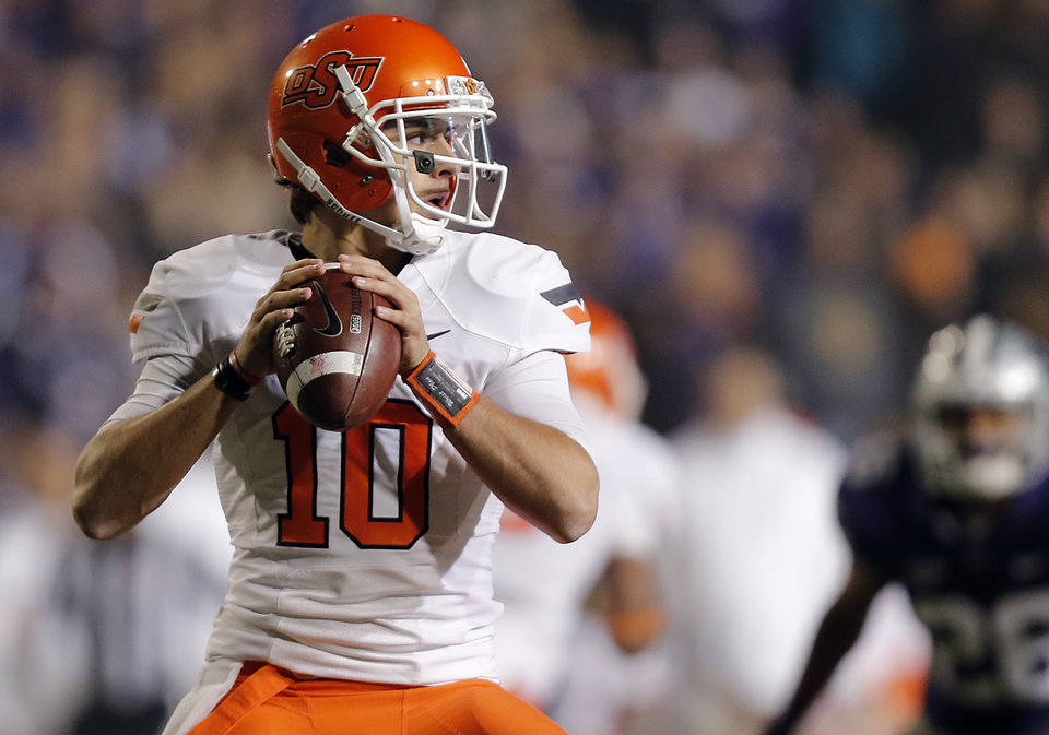 Oklahoma State\'s Clint Chelf (10) looks to pass the ball during the OSU-Kansas State football game Saturday, Nov. 1, 2012, in Manhattan, Kan. Photo by Chris Landsberger, The Oklahoman