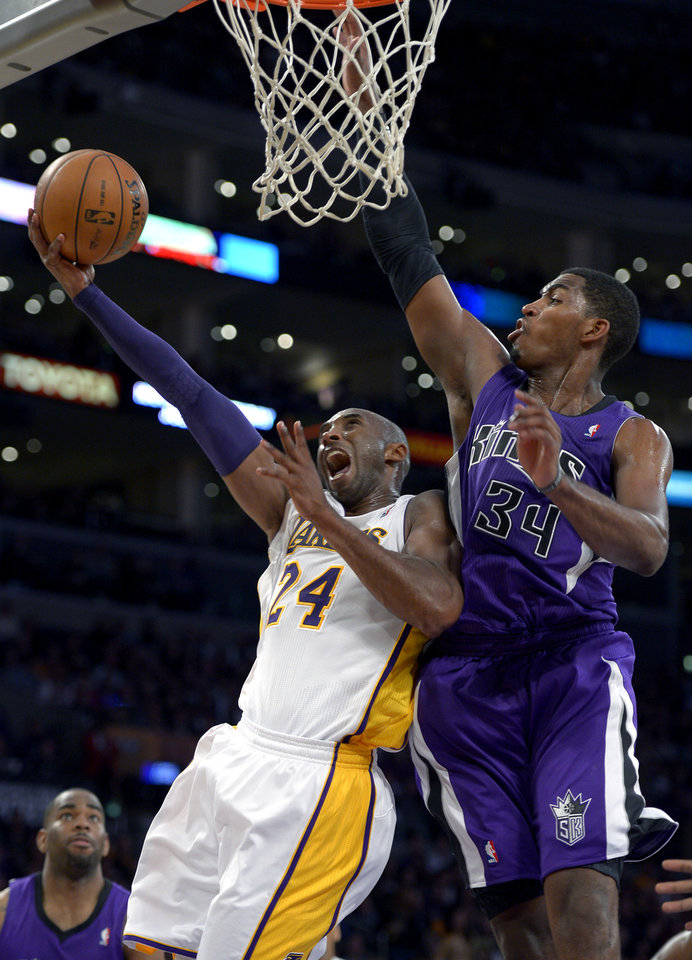 Photo -   Los Angeles Lakers guard Kobe Bryant, left, puts up a shot as Sacramento Kings forward Jason Thompson defends during the second half of their NBA basketball game, Sunday, Nov. 11, 2012, in Los Angeles. The Lakers won 103-90. (AP Photo/Mark J. Terrill)