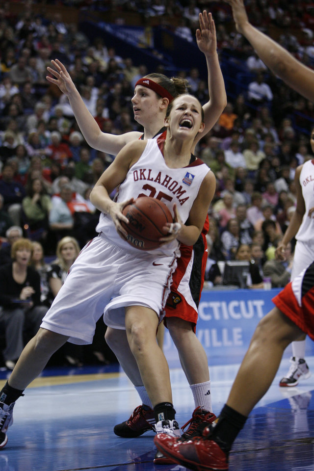 Photo - Whitney Hand is fouled while driving to the baskey in the second half as the University of Oklahoma plays Louisville at the 2009 NCAA women's basketball tournament Final Four in the Scottrade Center in Saint Louis, Missouri on Sunday, April 5, 2009. 