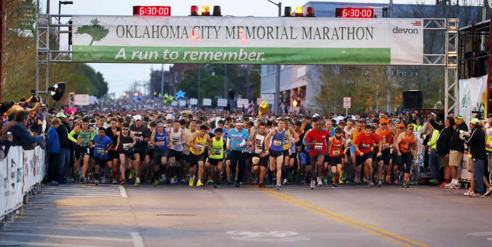 Photo - Runners start the Oklahoma City Memorial Marathon, heading south on Harvey Ave., in Oklahoma City, Sunday, April 28, 2013. Photo by Nate Billings, The Oklahoman