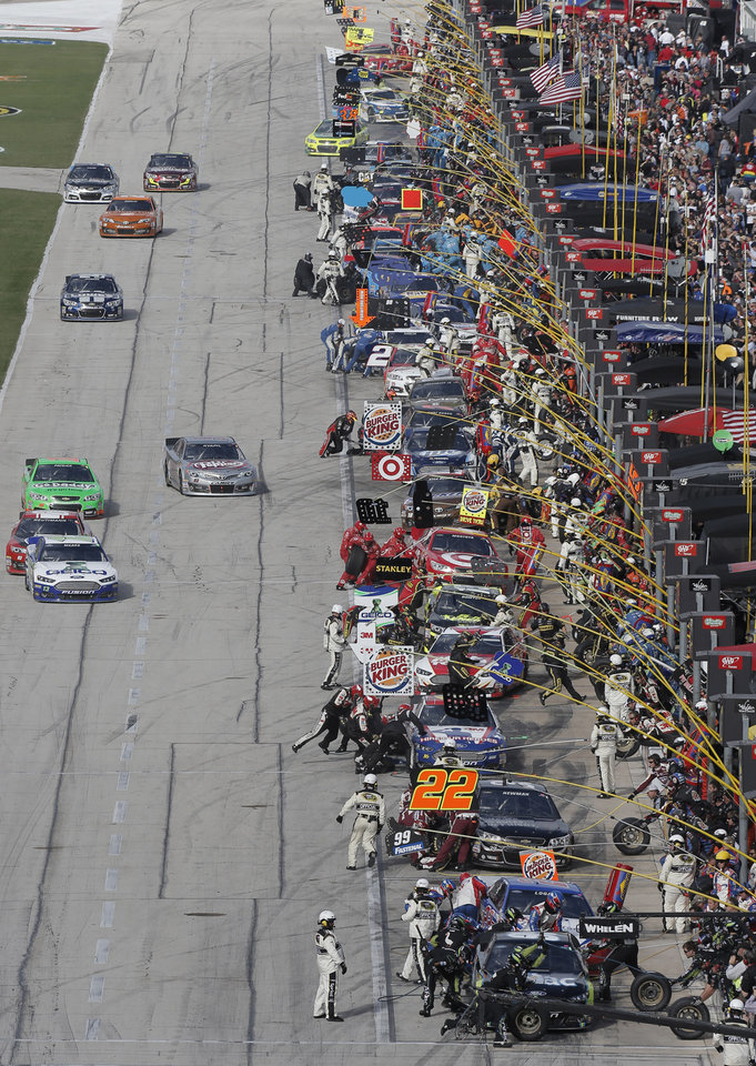 Photo - Pitt row crews work on cars during the NASCAR Sprint Cup series auto race at Texas Motor Speedway in Fort Worth, Texas, Sunday, Nov. 3, 2013.   (AP Photo/Brandon Wade)