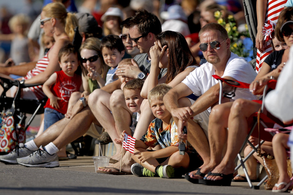 A crowd watches the LibertyFest Fourth of July Parade in Edmond, Okla., Wednesday, July 4, 2012. Photo by Bryan Terry, The Oklahoman