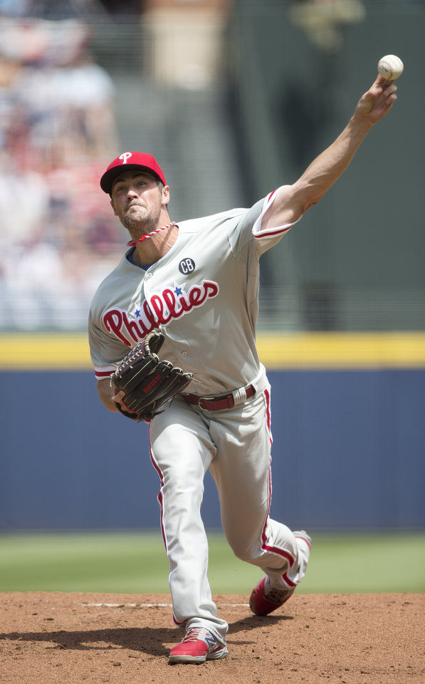 Photo - Philadelphia Phillies starting pitcher Cole Hamels works against the Atlanta Braves in the first inning of a baseball game Monday, Sept. 1, 2014, in Atlanta. (AP Photo/John Bazemore)