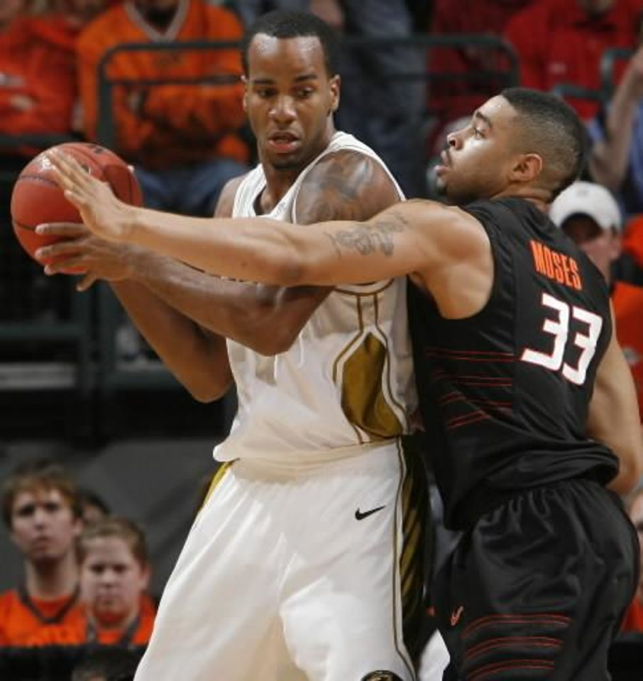 Photo - OSU's Marshall Moses (33) defends on Missouri's Leo Lyons in the semifinal game of the Big 12  Men's Basketball Championships between Oklahoma State University and The University of Missouri at the Ford Center on Friday, March 13, 2009, in Oklahoma City, Okla. PHOTO BY CHRIS LANDSBERGER, THE OKLAHOMAN