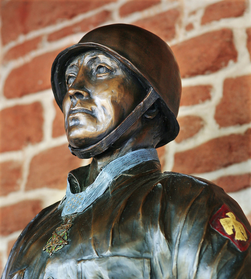 Photo - This statue of Ernest Childers was unveiled  at the 45th Infantry  Division Museum in  Oklahoma City on Friday.  PHOTO BY Jim Beckel,  The Oklahoman