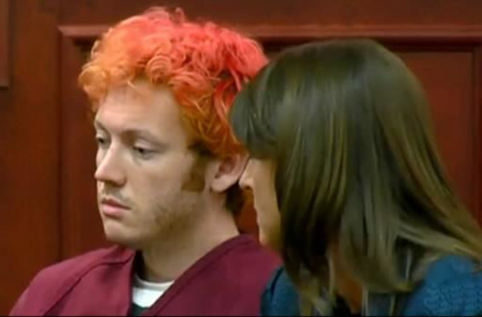 Photo - In this image taken from video provided by KUSA.com, James Holmes, left, the suspected gunman in Friday's Colorado theater massacre, makes his first appearance in court with his attorney in Aurora, Colo., Monday, July 23, 2012. (AP Photo/KUSA.com)